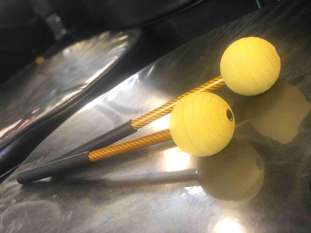 CultureMix steel pan sticks for bass - gold carbon fibre with black grip