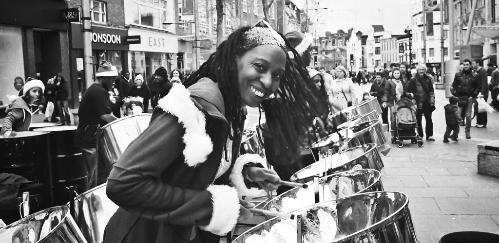 Calypso and Carols Reading All Steel Percussion Orchestra entertain shoppers with festive music.