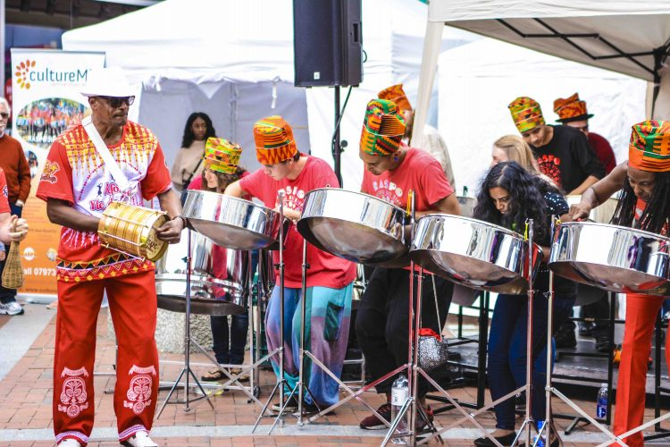 CultureMix Carnival of the World Reading All Steel Percussion Orchestra and Isaac Yle De Egba by Robert Varga Peterson