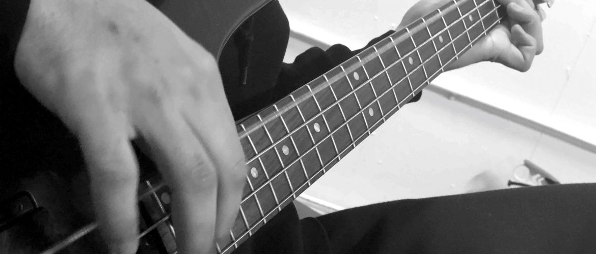 Bass guitar with hands playing culturemixarts