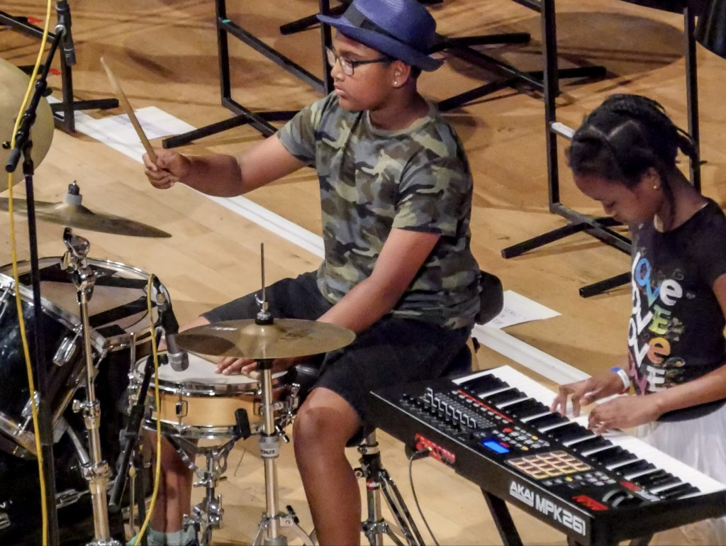 Children play keyboards and drums culturemixarts