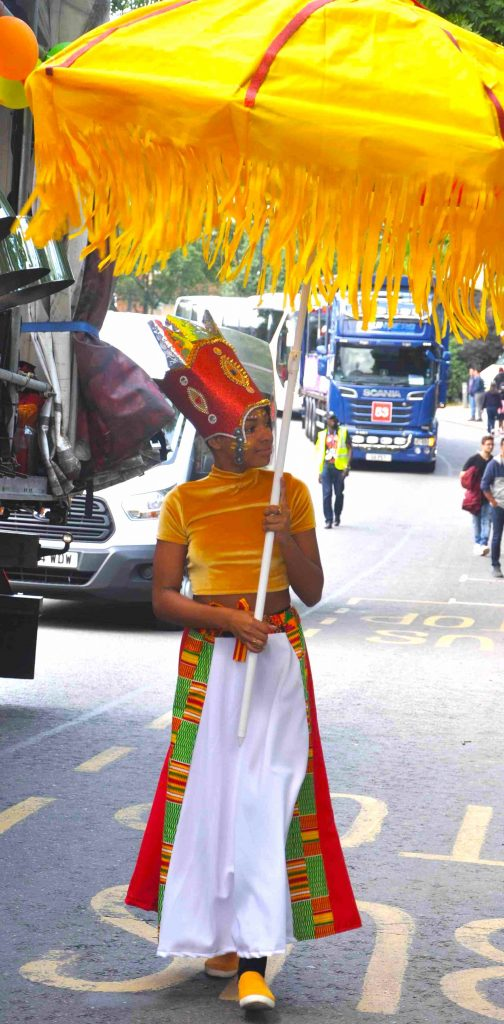 CultureMix Carnival of the World at London Notting Hill Carnival costume with parasol