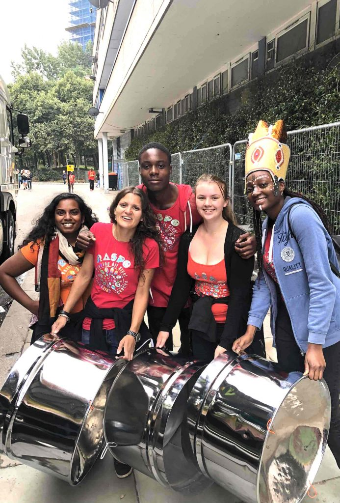 Notting Hill Carnival 2018 Anisha Abi Godly Rosie Aisha carry steel drum pans to the RASPO float