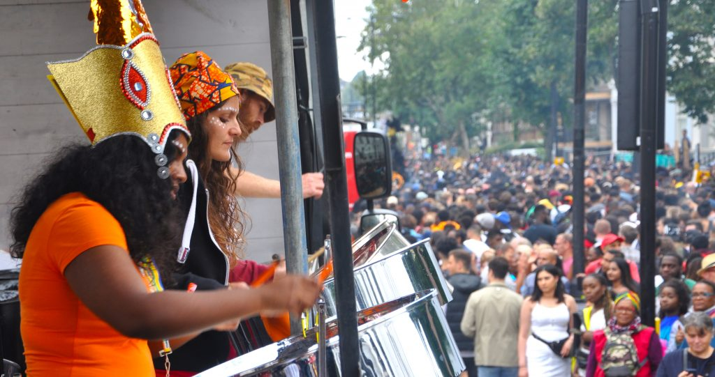 London Notting Hill Carnival 2018 RASPO Steel Band float with steel pan drums and carnival crowd image by CultureMixArts