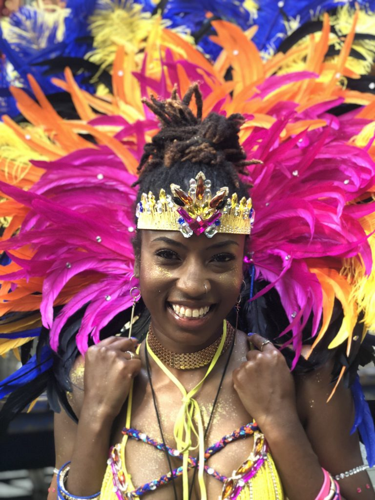 Lea Kidd in carnival costume with RASPO Steel Orchestra at Notting Hill Carnival 2019 by CultureMix Arts Ltd