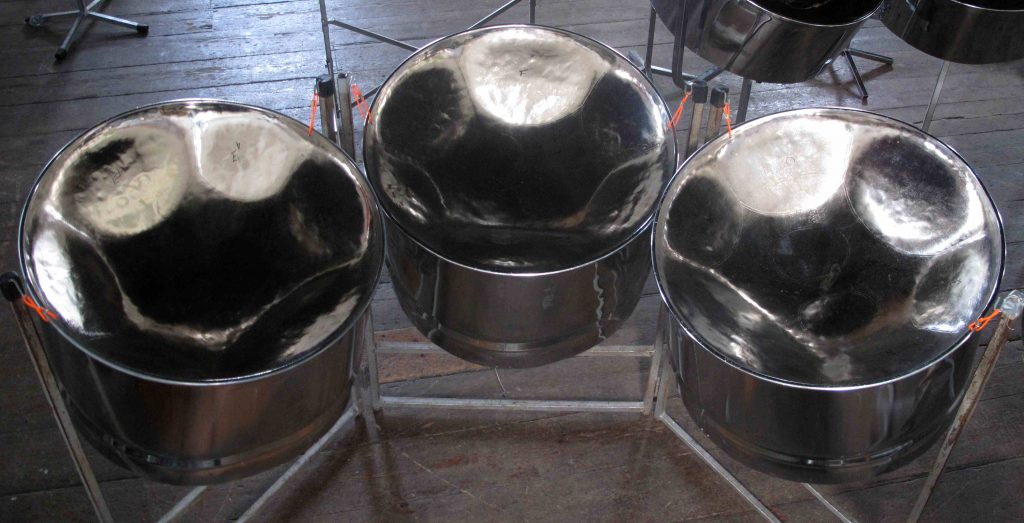 Cello pans also known as triple guitars are steel pan drums and part of the steel band.  Image Mary Genis CultureMix Arts