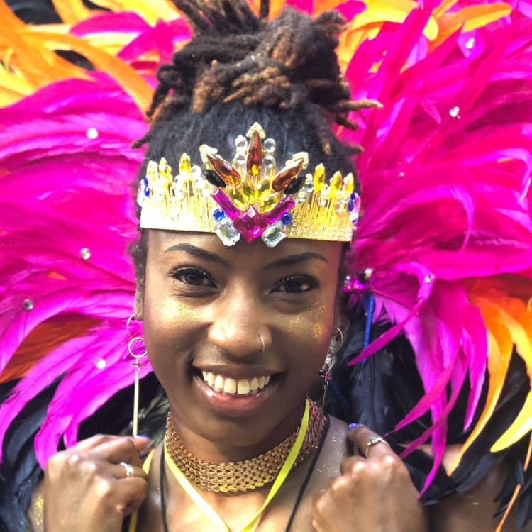 Lea from RASPO wears a feathered costume for London Notting Hill Carnival
