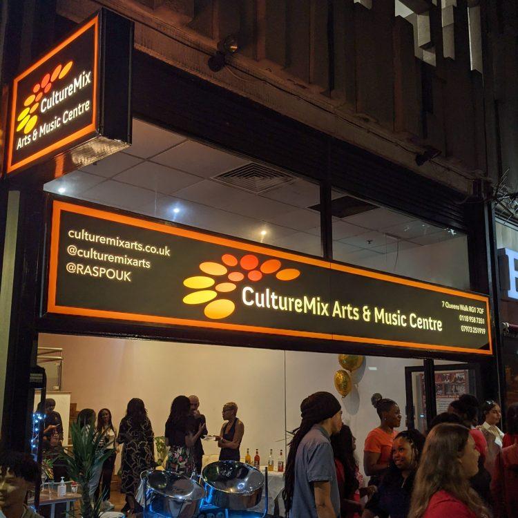 CultureMix Centre shop window at night Sep2021 image by Rabble Theatre